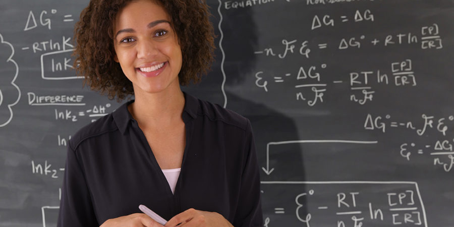 BE THE WAIE Campaign Phase 1 - Portrait of black teacher giving math lesson on chalkboard