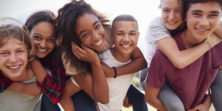 Phase 3 - Homeless and Runaway Teen House - Teenage school friends having fun piggybacking outdoors