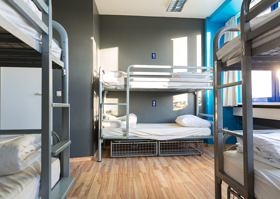 Coliving - Hostel interior, metal bunk beds and linen, nobody